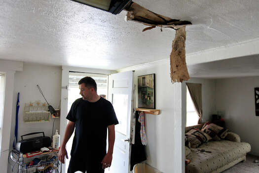 Robert Boles, 35, looks at the damage to his home, Sunday April 21, 2013, after an explosion at a fertilizer plant that occurred Wednesday evening in West, Tx. Photo: Edward A. Ornelas, Express-News / © 2013 San Antonio Express-News