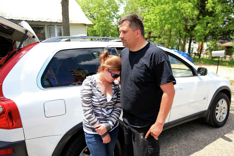 Tamisha, 26, and Robert Boles, 35, talk ,Sunday April 21, 2013, about the damage to their home after