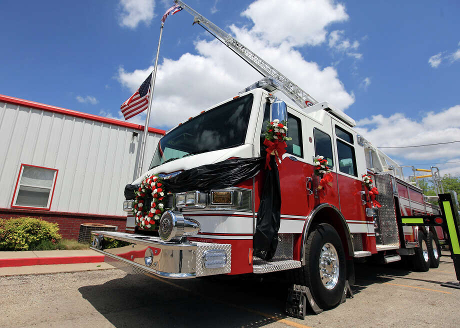 A ladder truck with flowers and a black ribbon outside the West Volunteer Fire Department headquarters, Sunday April 21, 2013, after an explosion at a fertilizer plant that occurred Wednesday evening in West, Tx.  The majority of those that died in the explosion were first responders. Photo: Edward A. Ornelas, Express-News / © 2013 San Antonio Express-News