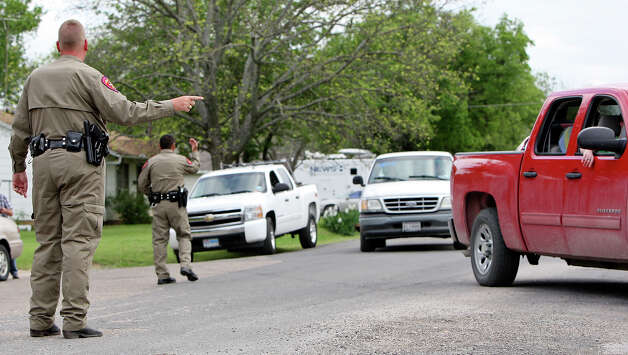Texas Department of Public Safety State Troopers direct residents ,Sunday April 21, 2013, back to their homes to retrieve belongings after an explosion at a fertilizer plant that occurred Wednesday evening in West, Tx. Photo: Edward A. Ornelas, Express-News / © 2013 San Antonio Express-News