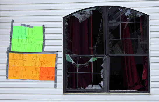 A missing dog sign on Trish Webre's home, Sunday April 21, 2013, that was damaged by an explosion at a fertilizer plant that occurred Wednesday evening in West, Tx. Photo: Edward A. Ornelas, Express-News / © 2013 San Antonio Express-News