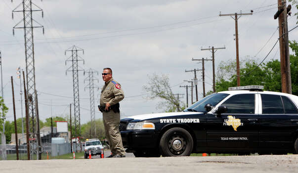 A Texas Department of Public Safety State Trooper blocks a street,Sunday April 21, 2013, after an explosion at a fertilizer plant that occurred Wednesday evening in West, Tx. Photo: Edward A. Ornelas, Express-News / © 2013 San Antonio Express-News
