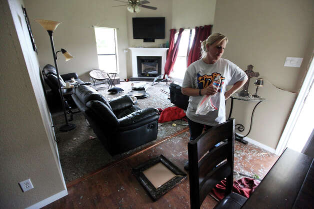 Janie Beheler pauses in her aunt's Trish Webre home, Sunday April 21, 2013, that was damaged by an explosion at a fertilizer plant that occurred Wednesday evening in West, Tx. Photo: Edward A. Ornelas, Express-News / © 2013 San Antonio Express-News