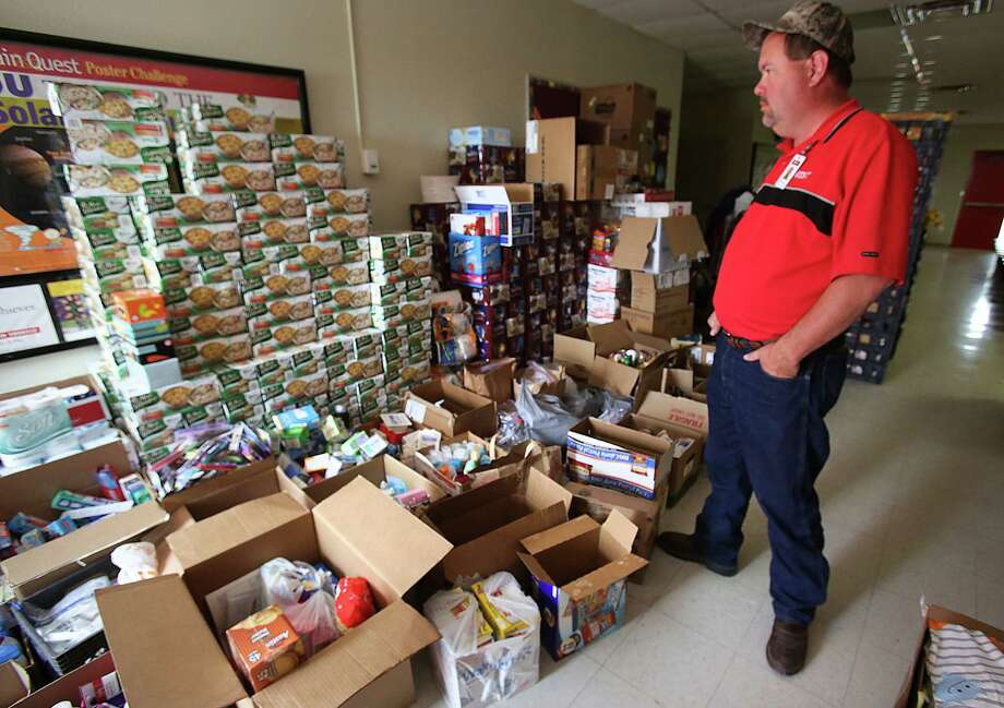 Charles Mikeska, Assistant Superintendent of West ISD, looks over donations made to the West Elementary School, on Sunday April 21, 2013. Photo: Bob Owen, Express-News / ©2013 San Antonio Express-News