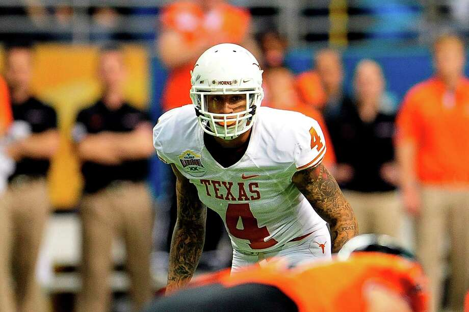 Texas' Kenny Vaccaro should be selected in the middle of the first round Thursday. Photo: Stacy Revere, Contributor / 2012 Stacy Revere