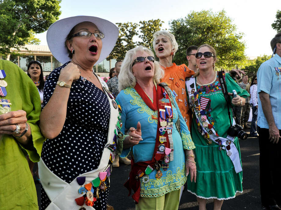 Liz Jauer (from left), Joan Gaither, Pris Trawick and Susan Heinemeyer of the Military Civilian Club sing the Army Fight Song at Fort Sam. Photo: Robin Jerstad / For The San Antonio Express-News