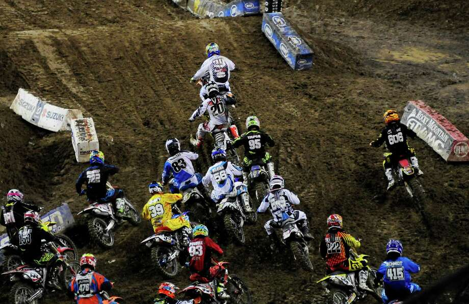 Andrew Short leads the 450SX Main Event at the first turn of the first lap at the Monster Energy AMA Supercross at CenturyLink Field on Saturday, April 20, 2013. Several wipeouts occurred throughout the night due to a muddy track from the afternoon's heavy rain. Justin Barcia of Pinetta, Fla. took the main event of the night, placing Seattle-favorite Ryan Villopoto in second. Photo: LINDSEY WASSON, Seattlepi.com / SEATTLEPI.COM