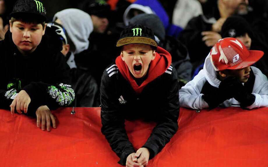 A young fan screams at Ryan Villopoto at the Monster Energy AMA Supercross at CenturyLink Field on Saturday, April 20, 2013. Several wipeouts occurred throughout the night due to a muddy track from the afternoon's heavy rain. Justin Barcia of Pinetta, Fla. took the main event of the night, placing Seattle-favorite Ryan Villopoto in second. Photo: LINDSEY WASSON, Seattlepi.com / SEATTLEPI.COM