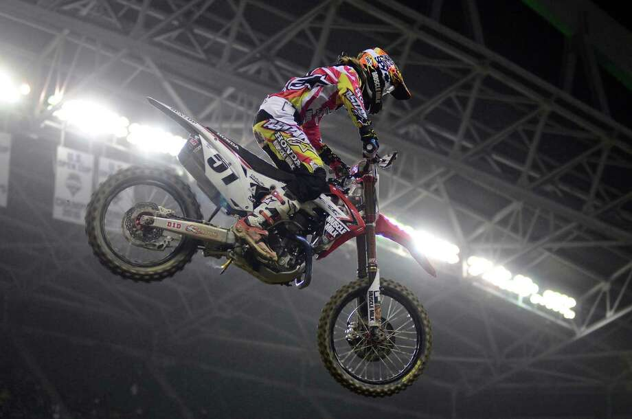 450SX Main Event winner Justin Barcia catches at least 30 feet of air as he comes off of one of the track's largest jumps during the Monster Energy AMA Supercross at CenturyLink Field on Saturday, April 20, 2013. Several wipeouts occurred throughout the night due to a muddy track from the afternoon's heavy rain. Justin Barcia of Pinetta, Fla. took the main event of the night, placing Seattle-favorite Ryan Villopoto in second. Photo: LINDSEY WASSON, Seattlepi.com / SEATTLEPI.COM