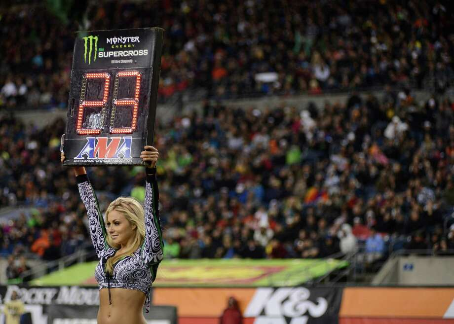 A Monster Energy model holds up a countdown timer for the 450SX Main Event at the Monster Energy AMA Supercross at CenturyLink Field on Saturday, April 20, 2013. Several wipeouts occurred throughout the night due to a muddy track from the afternoon's heavy rain. Justin Barcia of Pinetta, Fla. took the main event of the night, placing Seattle-favorite Ryan Villopoto in second. Photo: LINDSEY WASSON, Seattlepi.com / SEATTLEPI.COM