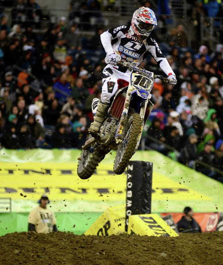 Justin Brayton competes during the 450SX Main Event at the Monster Energy AMA Supercross at CenturyLink Field on Saturday, April 20, 2013. Several wipeouts occurred throughout the night due to a muddy track from the afternoon's heavy rain. Justin Barcia of Pinetta, Fla. took the main event of the night, placing Seattle-favorite Ryan Villopoto in second. Photo: LINDSEY WASSON, Seattlepi.com / SEATTLEPI.COM