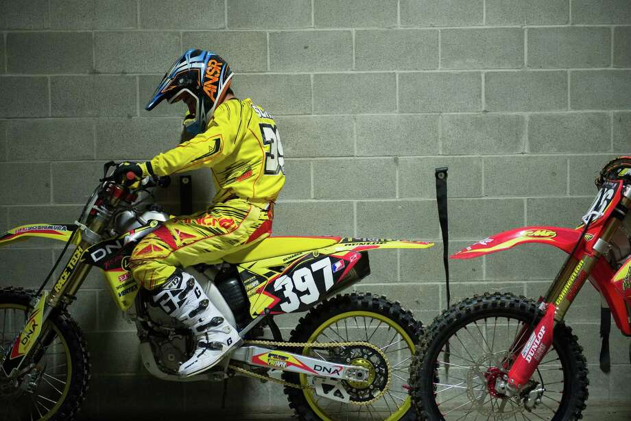 Brandon Scharer rests against a wall in the racer's tunnel as he waits to participate in the 250SX main event at the Monster Energy AMA Supercross at CenturyLink Field on Saturday, April 20, 2013. Several wipeouts occurred throughout the night due to a muddy track from the afternoon's heavy rain. Justin Barcia of Pinetta, Fla. took the main event of the night, placing Seattle-favorite Ryan Villopoto in second. Photo: LINDSEY WASSON, Seattlepi.com / SEATTLEPI.COM