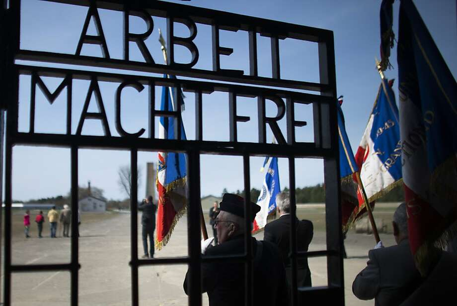 Members of veteran associations arrives at the entrance of Nazi death camp Sachsenhausen with the slogan 'Arbeit macht Frei' , meaning 'labor makes  free' on the eve of the 68th anniversary of the liberation of the camp in Oranienburg, around 50 kilometers ( 30 miles) north of Berlin, Sunday, April 21, 2013. On April 22, 1945 Soviet red army soldiers arrived at Sachsenhausen and liberated the remain prisoners of the camp. (AP Photo/Markus Schreiber) Photo: Markus Schreiber, Associated Press