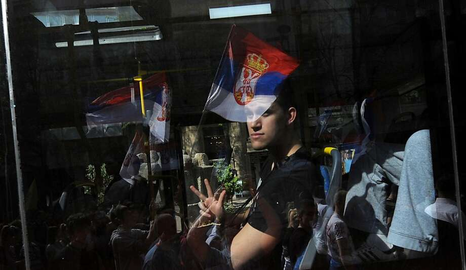 A man in a bus gestures to a group of Serbian ultra nationalists during a protest on April 21, 2013, in Belgrade. Serbia and its former province of Kosovo initialled a historic deal Friday to normalise ties, a move key to the future of the Western Balkans and destined also to bring both closer to the European Union.   AFP PHOTO / ALEXA STANKOVICALEXA STANKOVIC/AFP/Getty Images Photo: Alexa Stankovic, AFP/Getty Images
