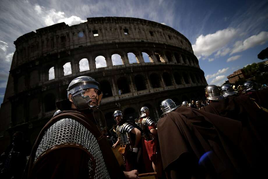 Men belonging to historical groups march dressed as ancient Romans during a parade in front of the coliseum to mark the anniversary of the legendary foundation of the eternal city in 753 B.C, in Rome on April 21, 2013.  TOPSHOTS AFP PHOTO / Filippo MONTEFORTEFILIPPO MONTEFORTE/AFP/Getty Images Photo: Filippo Monteforte, AFP/Getty Images