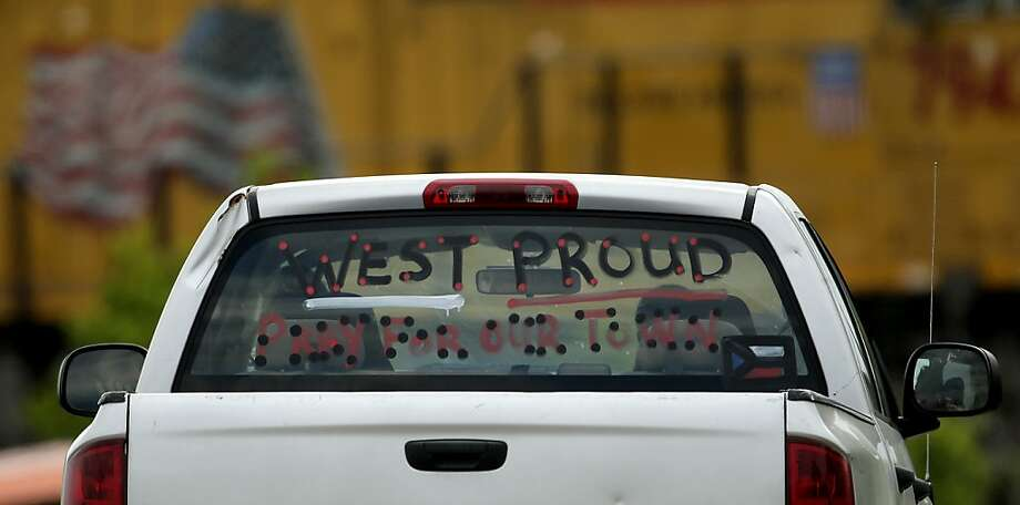 A sign is seen on a pickup window as it passes near the ruins of the West Fertilizer Co. Sunday, April 21, 2013, four days after an explosion at the plant in West, Texas. The massive explosion Wednesday night killed 14 people and injured more than 160. (AP Photo/Charlie Riedel) Photo: Charlie Riedel, Associated Press
