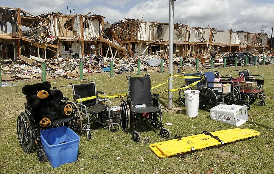 Wheelchairs are seen outside a damaged apartment complex Sunday, April 21, 2013, four days after an explosion at a fertilizer plant in West, Texas. The massive explosion at the West Fertilizer Co. Wednesday night killed 14 people and injured more than 160. (AP Photo/Dallas Morning News, Michael Ainsworth, pool) Photo: Michael Ainsworth, Associated Press