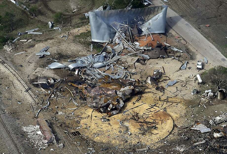 This Thursday April 18, 2013, aerial photo shows the remains of a fertilizer plant destroyed by an explosion in West, Texas. The massive explosion at the West Fertilizer Co. Wednesday night killed at least 14 people and injured more than 160. (AP Photo/Tony Gutierrez) Photo: Tony Gutierrez, Associated Press