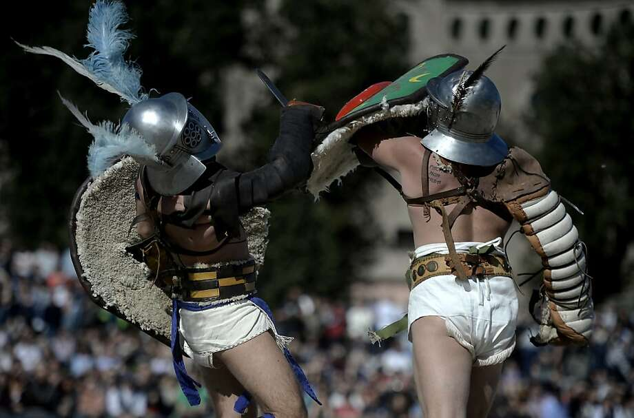 Men belonging to historical groups fight dressed as ancient Roman gladiators during a show to mark the anniversary of the legendary foundation of the eternal city in 753 B.C, in Rome on April 21, 2013.  AFP PHOTO / Filippo MONTEFORTEFILIPPO MONTEFORTE/AFP/Getty Images Photo: Filippo Monteforte, AFP/Getty Images