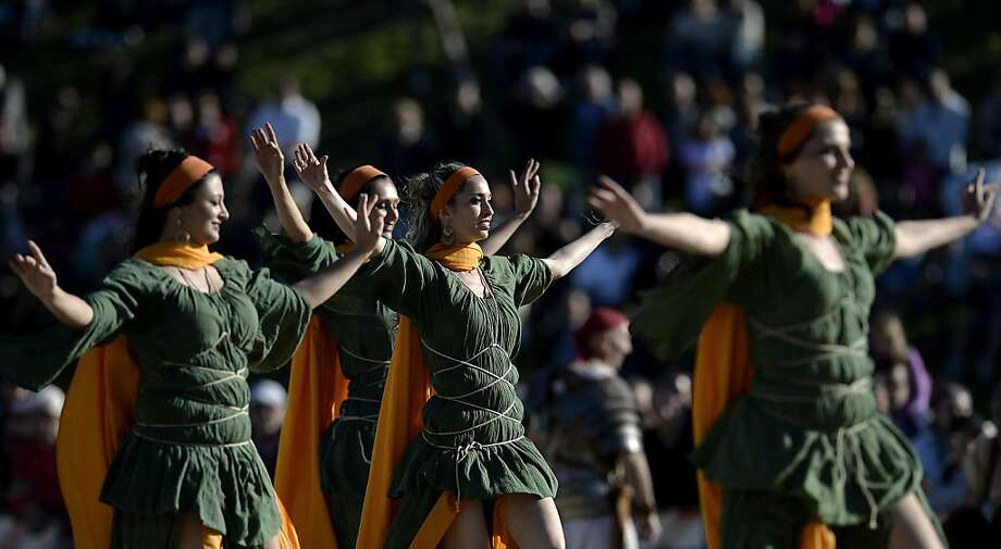 Women belonging to historical groups dance dressed as ancient Romans during a show to mark the anniversary of the legendary foundation of the eternal city in 753 B.C, in Rome's Circo Massimo on April 21, 2013.  AFP PHOTO / Filippo MONTEFORTEFILIPPO MONTEFORTE/AFP/Getty Images Photo: Filippo Monteforte, AFP/Getty Images