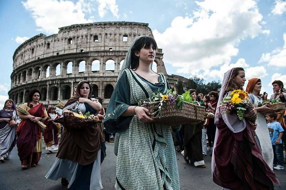 ROME, ITALY - APRIL 21: Actors dressed as ancient Roman maids march in front of the Coliseum in a commemorative parade during festivities marking the 2,766th anniversary of the founding of Rome on April 21, 2013 in Rome, Italy. The capital celebrates its founding annually based on the legendary foundation of the Birth of Rome. Actors dressed as the denizens of ancient Rome participate in parades and re-enactments of the ancient Roman Empire. According to legend, Rome had been founded by Romulus in 753 BC in an area surrounded by seven hills. (Photo by Giorgio Cosulich/Getty Images) Photo: Giorgio Cosulich, Getty Images