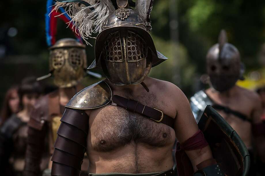 ROME, ITALY - APRIL 21: Actors dressed as ancient gladiators march in front of the Coliseum in a commemorative parade during festivities marking the 2,766th anniversary of the founding of Rome on April 21, 2013 in Rome, Italy. The capital celebrates its founding annually based on the legendary foundation of the Birth of Rome. Actors dressed as the denizens of ancient Rome participate in parades and re-enactments of the ancient Roman Empire. According to legend, Rome had been founded by Romulus in 753 BC in an area surrounded by seven hills. (Photo by Giorgio Cosulich/Getty Images) Photo: Giorgio Cosulich, Getty Images