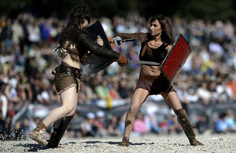 Women belonging to historical groups fight dressed as ancient Roman gladiators during a show to mark the anniversary of the legendary foundation of the eternal city in 753 B.C, in Rome on April 21, 2013.  AFP PHOTO / Filippo MONTEFORTEFILIPPO MONTEFORTE/AFP/Getty Images Photo: Filippo Monteforte, AFP/Getty Images