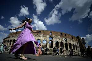 Women belonging to historical groups march dressed as ancient Romans during a parade in front of the coliseum to mark the anniversary of the legendary foundation of the eternal city in 753 B.C, in Rome on April 21, 2013.  AFP PHOTO / Filippo MONTEFORTEFILIPPO MONTEFORTE/AFP/Getty Images