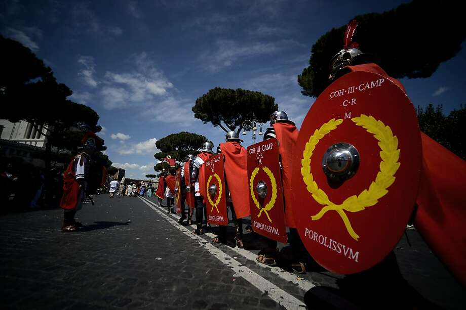 Men belonging to historical groups march dressed as ancient Romans during a parade to mark the anniversary of the legendary foundation of the eternal city in 753 B.C, in Rome on April 21, 2013.  AFP PHOTO / Filippo MONTEFORTEFILIPPO MONTEFORTE/AFP/Getty Images Photo: Filippo Monteforte, AFP/Getty Images
