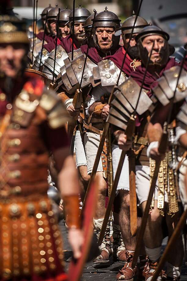 ROME, ITALY - APRIL 21: Actors dressed as ancient Roman soldiers march in a commemorative parade during festivities marking the 2,766th anniversary of the founding of Rome on April 21, 2013 in Rome, Italy. The capital celebrates its founding annually based on the legendary foundation of the Birth of Rome. Actors dressed as the denizens of ancient Rome participate in parades and re-enactments of the ancient Roman Empire. According to legend, Rome had been founded by Romulus in 753 BC in an area surrounded by seven hills. (Photo by Giorgio Cosulich/Getty Images) Photo: Giorgio Cosulich, Getty Images