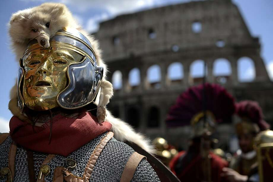 Men belonging to historical groups march dressed as ancient Romans during a parade in front of the coliseum to mark the anniversary of the legendary foundation of the eternal city in 753 B.C, in Rome on April 21, 2013.  AFP PHOTO / Filippo MONTEFORTEFILIPPO MONTEFORTE/AFP/Getty Images Photo: Filippo Monteforte, AFP/Getty Images