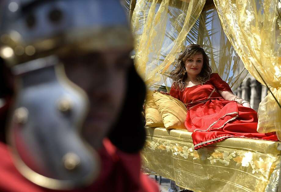 People belonging to historical groups march dressed as ancient Romans during a parade to mark the anniversary of the legendary foundation of the eternal city in 753 B.C, in Rome on April 21, 2013.  AFP PHOTO / Filippo MONTEFORTEFILIPPO MONTEFORTE/AFP/Getty Images Photo: Filippo Monteforte, AFP/Getty Images