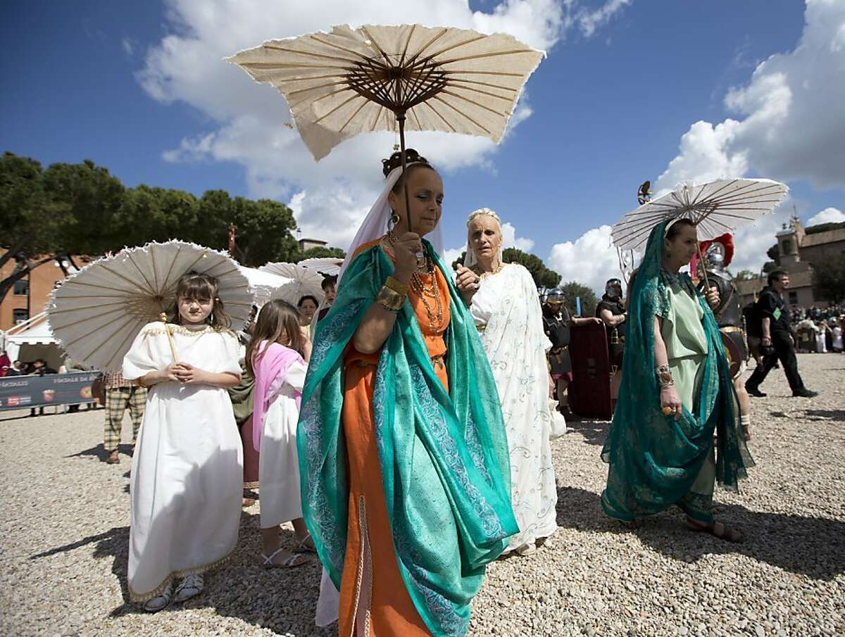 Ancient Roman costumed groups of people parade in the ancient areas of Colosseum , Circus Maximus and the Roman Forum to celebrate the festivities of Christmas of Rome, in Rome, Sunday, April 21, 2013. Legend says that Rome was founded by Romulus in 753 BC in an area surrounded by seven hills. Every year the city celebrates the Birth of Rome with parades and fighting in costume, re-enacting the deeds of the great ancient Roman Empire. (AP Photo/Andrew Medichini)