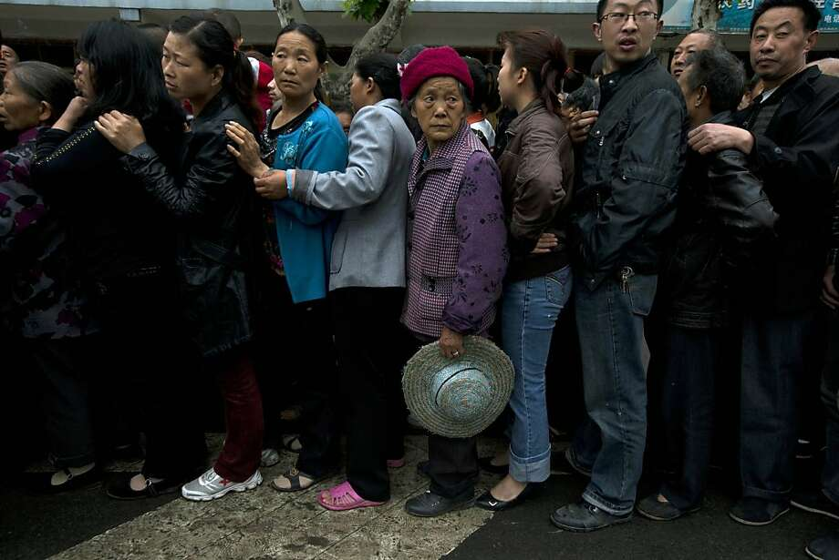 Residents line up for packets of instant noodles in the earthquake struck county of Lushan in southwestern China's Sichuan province, Monday, April 22, 2013. Saturday's earthquake in Sichuan province killed at least 186 people, injured more than 11,000 and left nearly two dozen missing, mostly in the rural communities around Ya'an city, along the same seismic fault where a devastating quake to the north killed more than 90,000 people in Sichuan and neighboring areas five years ago in one of China's worst natural disasters.(AP Photo/Ng Han Guan) Photo: Ng Han Guan, Associated Press