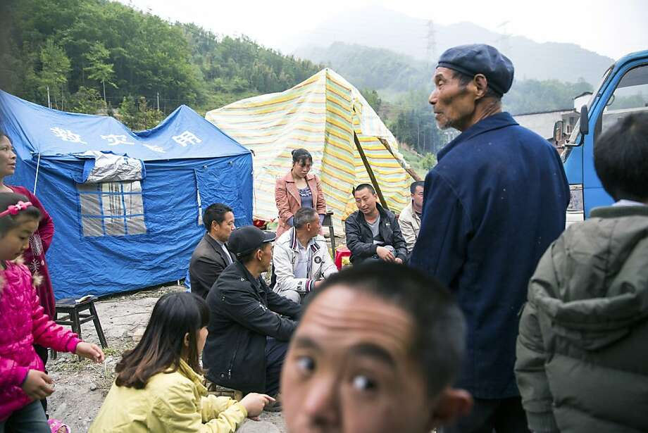 People around a fire in Yuxi, China, where residents evacuated to tents following Saturday's earthquake, April 21, 2013. An earthquake killed at least 160 people in Sichuan province Saturday and injured about 5,700, evoking memories of the 2008 earthquake that killed more than 70,000 in the same region. (Sim Chi Yin/The New York Times) Photo: Sim Chi Yin, New York Times