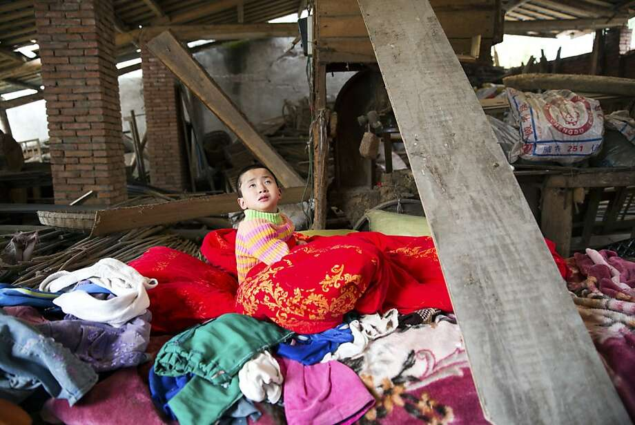 A young girl who is disabled sits in a makeshift shelter after her family's house was rendered dangerous by the earthquake Saturday, in Yuxi, China, April 21, 2013. An earthquake killed at least 160 people in Sichuan province Saturday and injured about 5,700, evoking memories of the 2008 earthquake that killed more than 70,000 in the same region. (Sim Chi Yin/The New York Times) Photo: Sim Chi Yin, New York Times