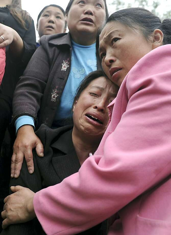 A woman cries for her relatives who were killed in an earthquake during a funeral in Longmen village in Lushan county in southwest China's Sichuan province Sunday, April 21, 2013. Rescuers and relief teams struggled to rush supplies into the rural hills of China's Sichuan province after an earthquake left at least 180 people dead and more than 11,000 injured and prompted frightened survivors to spend a night in cars, tents and makeshift shelters. (AP Photo) CHINA OUT Photo: Associated Press