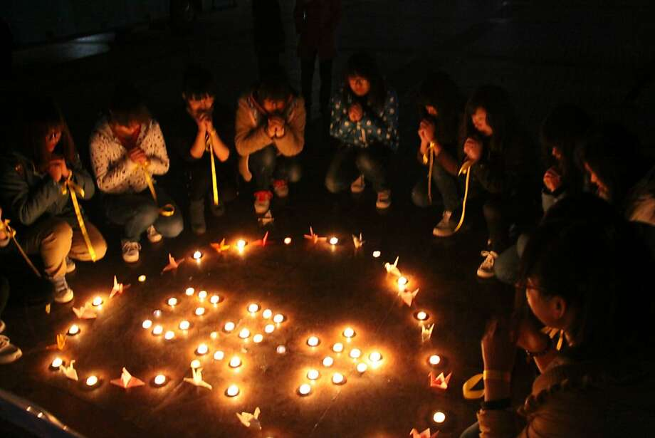 LIAOCHENG, CHINA - APRIL 20:  (CHINA OUT) Students light candles to pray for quake victims at Liaocheng University on April 20, 2013 in Liaocheng, China. A powerful earthquake struck the steep hills of China's southwestern Sichuan province Saturday morning, leaving at least 160 people dead and more than 6,700 injured.  (Photo by ChinaFotoPress/ChinaFotoPress via Getty Images) Photo: ChinaFotoPress, ChinaFotoPress Via Getty Images