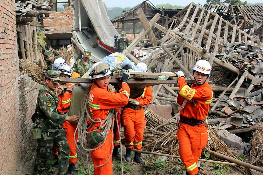 In this photo released by China's Xinhua News Agency, rescuers carry out an elderly paralyzed person from a collapsed house after an earthquake struck, in Qingren Township, Lushan County, Ya'an City, southwest China's Sichuan Province, Saturday, April 20, 2013. A powerful earthquake struck the steep hills of China's southwestern Sichuan province Saturday morning, leaving at least 160 people dead and more than 6,700 injured. (AP Photo/Xinhua, Le Xiaoxuan) NO SALES Photo: Le Xiaoxuan, Associated Press