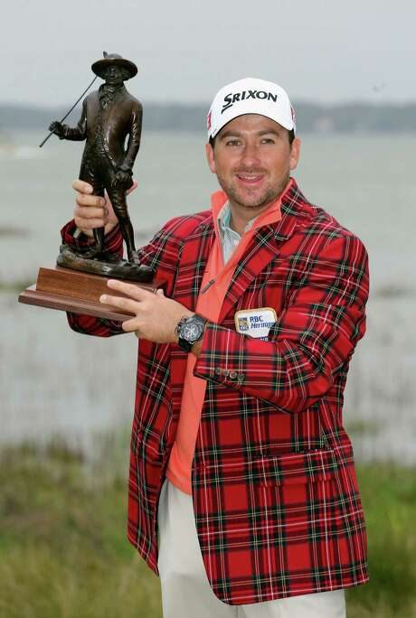 Northern Ireland's Graeme McDowell, who missed the Masters cut last week, hoists the RBC Heritage trophy. Photo: Streeter Lecka / Getty Images