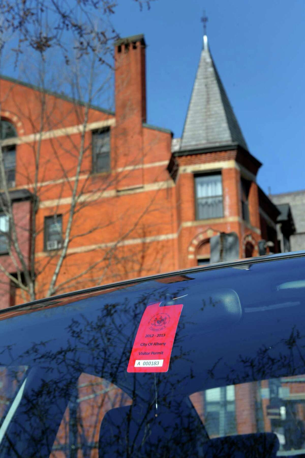 Visitor parking tag hangs on the rear view mirror of a parked car in Center Square on Wednesday, April 17, 2013, in Albany, N.Y. (Cindy Schultz / Times Union)