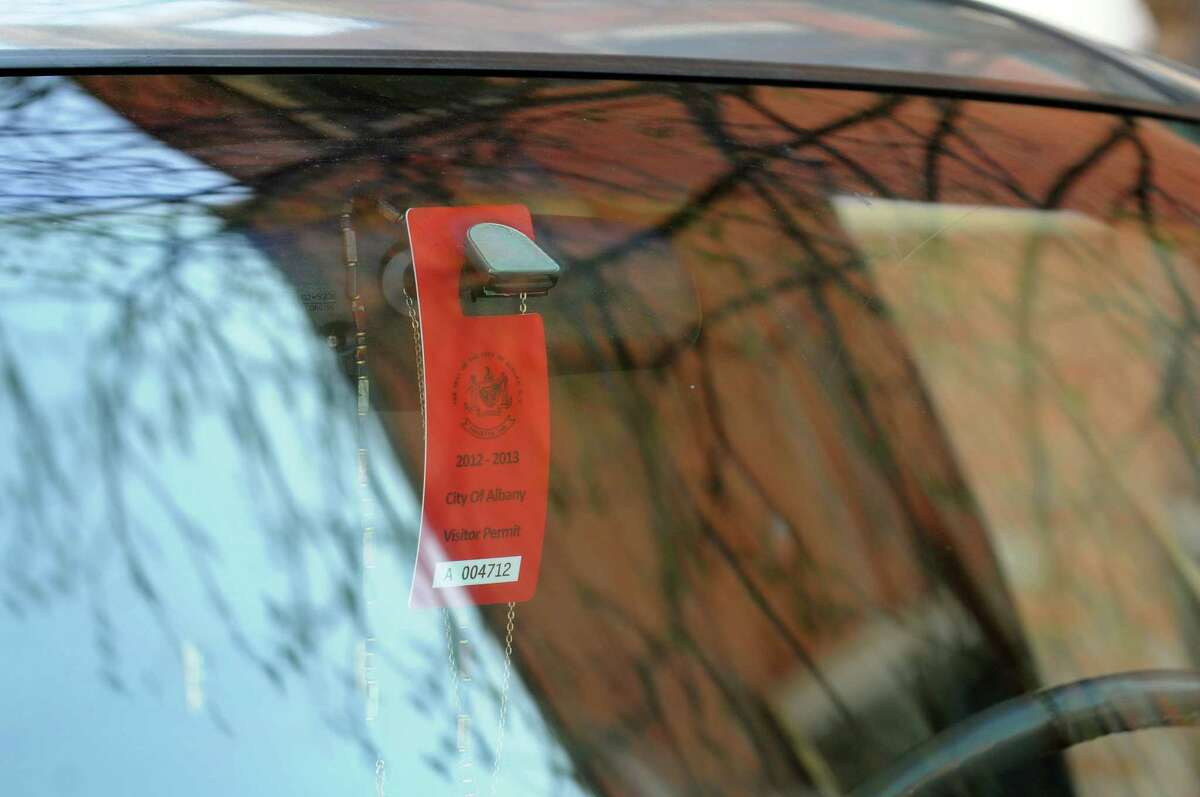 Visitor parking tag hangs on the rear view mirror of of a parked car in Center Square on Wednesday, April 17, 2013, in Albany, N.Y. (Cindy Schultz / Times Union)