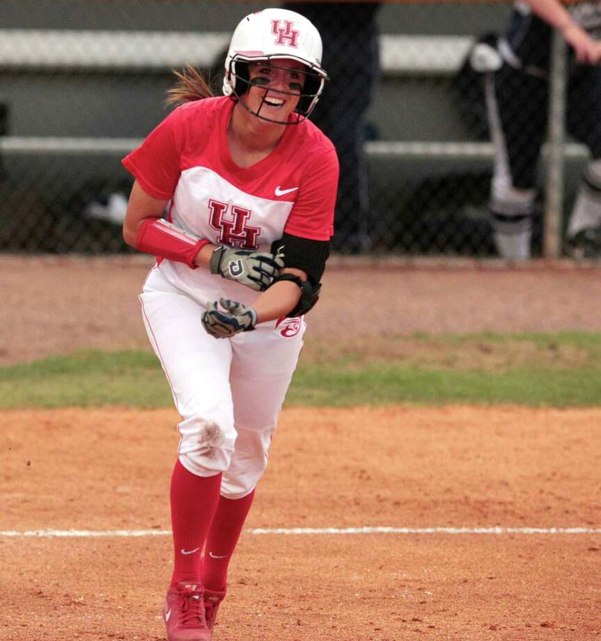 UH's Kendra Cullum is all smiles as she heads to first base after one of her 26 times getting hit by pitches this season. But the damage inflicted on her left leg by the frequent HBPs, right, is no laughing matter. Photo: Billy Smith II, Staff / ©2013 Houston Chronicle