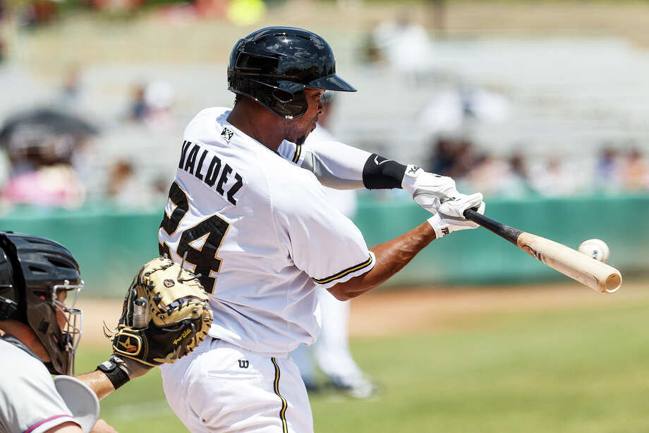 San Antonio Missions' Jeudy Valdez connects with a pitch during the second inning of their game with the Midland RockHounds at Wolff Stadium on Sunday, April 21, 2013. Midland defeated the Missions 3-1.  MARVIN PFEIFFER/ mpfeiffer@express-news.net Photo: MARVIN PFEIFFER, Express-News / Express-News 2013