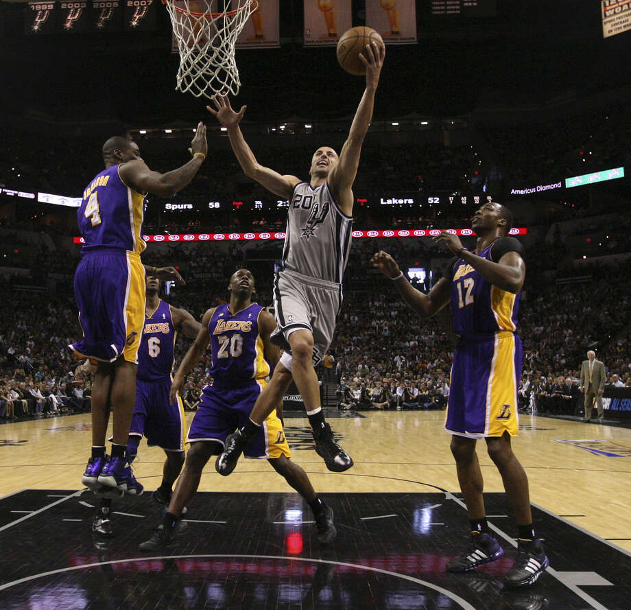 Manu Ginobili drives between L.A.'s Antawn Jamison (4), Earl Clark (6), Jodie Meeks (20) and Dwight Howard in his second game back from a hamstring injury. Photo: Jerry Lara / San Antonio Express-News