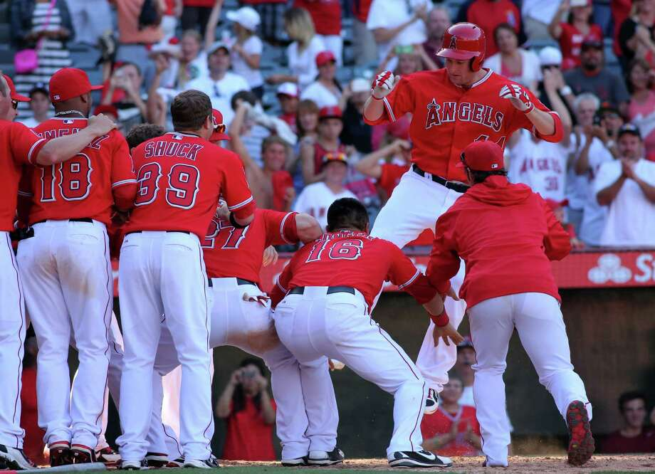 The Angels' Mark Trumbo takes one giant leap to hit the plate after his walk-off homer beat the Tigers. Photo: Stephen Dunn, Staff / 2013 Getty Images