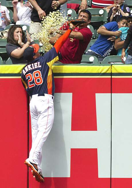 Astros right fielder Rick Ankiel leaps in vain for a home run hit by Indians right fielder Drew Stubbs in the sixth inning. Photo: Brett Coomer / Houston Chronicle
