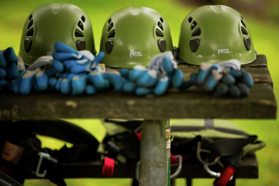 """Helmets and gloves await use during a tree-climbing event put on by the Seattle-local, eco-adventuring Canopy Climbers in honor of Earth Day on Sunday at Volunteer Park in Seattle. Attendees took turns ascending a 110-foot red oak named """"Her Majesty."""" Photo: JORDAN STEAD, SEATTLEPI.COM / SEATTLEPI.COM"""