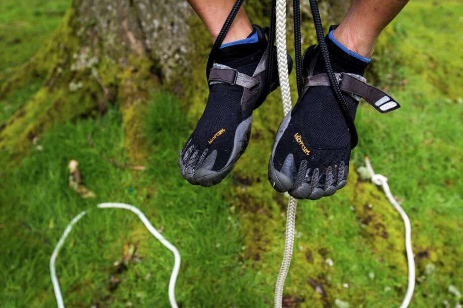 "While some climbers opted for regular shoes, Lorenzo Delara used toe-shoes for his ascent at a tree-climbing event put on by the Seattle-local, eco-adventuring Canopy Climbers in honor of Earth Day on Sunday at Volunteer Park in Seattle. Attendees took turns ascending a 110-foot red oak named ""Her Majesty."" Photo: JORDAN STEAD, SEATTLEPI.COM / SEATTLEPI.COM"