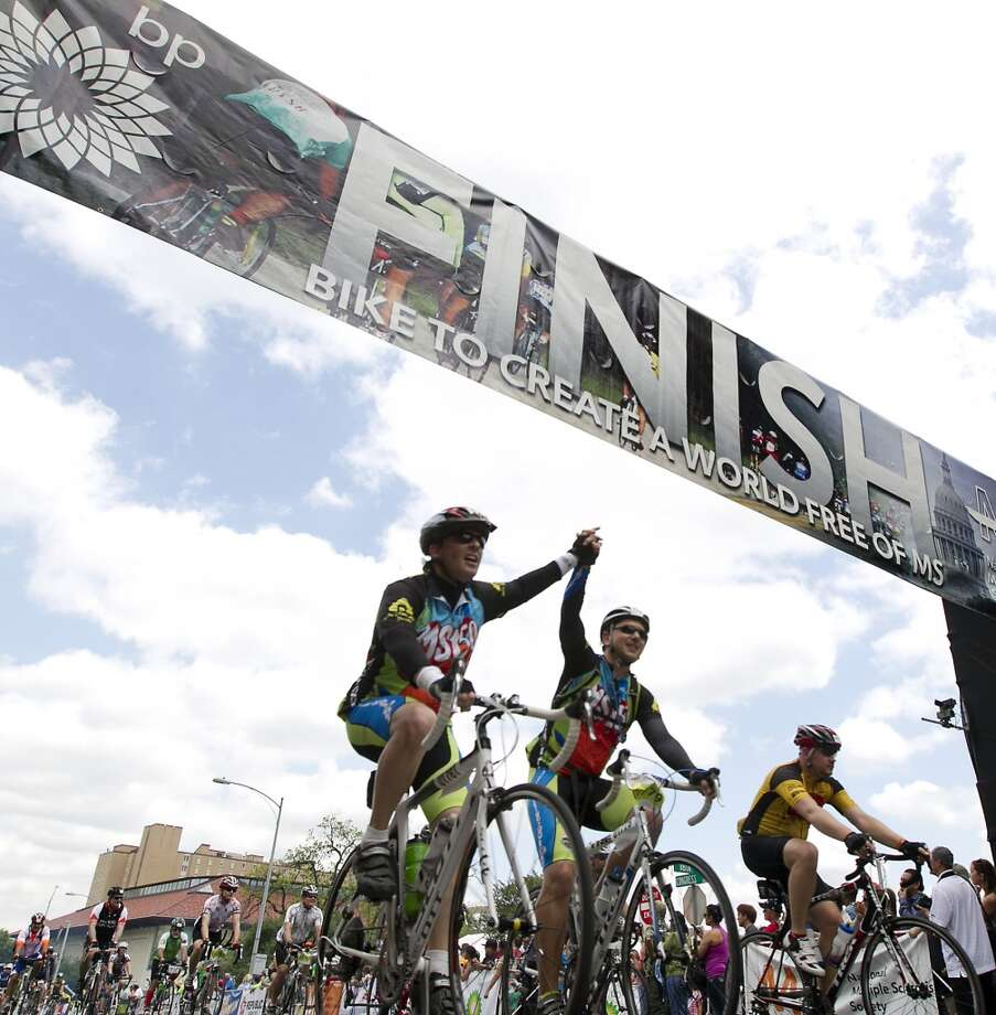Riders celebrate as the cross the finish line during the 29th Annual BP MS 150 in Austin on Sunday, April 21, 2013.